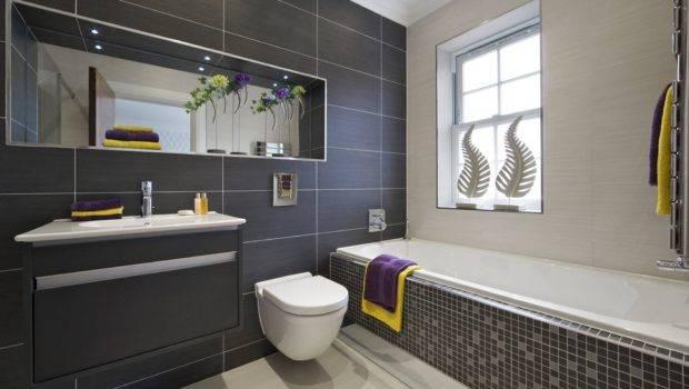 Bathroom Tiles Along Black Rugs White