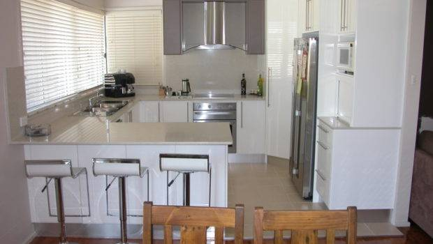 Classic Shaped Kitchen Design Using Polished Concrete