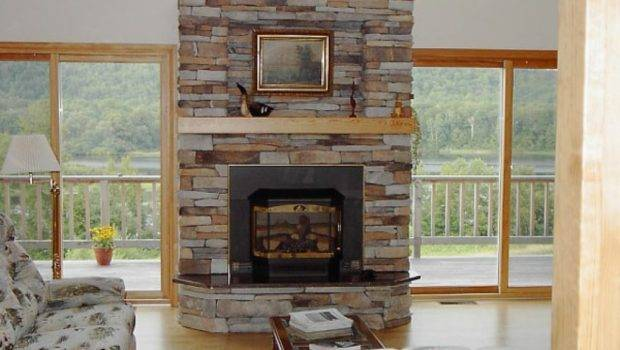 Dry Stacked Stone Fireplace Uses Colorful River Stones