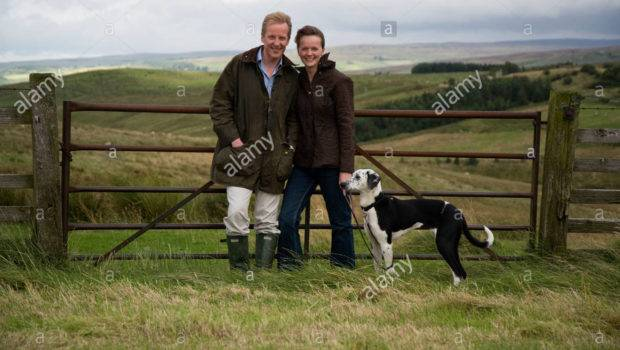 Married Couple Pet Dog Enjoying Their Country Lifestyle
