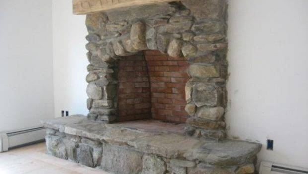 Rustic Field Stone Fireplace Has Hearth Large Timber