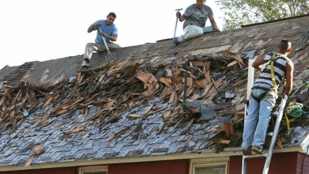 Stripping Old Roof Pueblo House