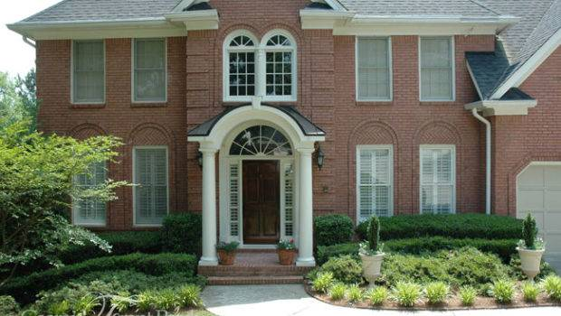 Two Story Brick Home Contemporary Style Portico Standing Seam