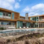 Wood Stone House Overlooks New York Coastline